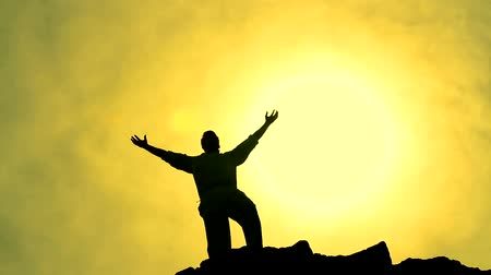 pohoří : Success Pose by Man on Top of Hill Lifting Hands toward Sun Color Background