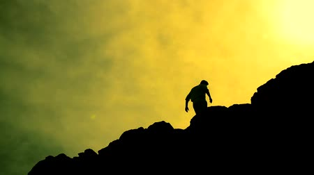alpinista : Climber Reaching Top of a Mountain Raising Hands Success Colorful Background HD Stock Footage