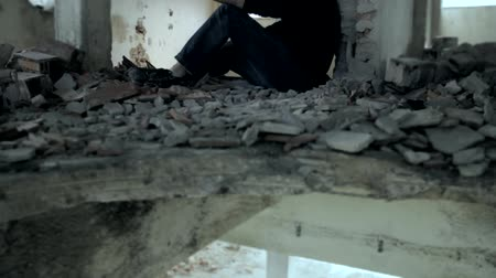 homeless : Man in Black Hoodie Getting High in Abandoned Building Addiction Concept HD