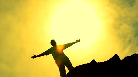 felicidade : Colorful Sky with Man in a Christ Like Pose Looking toward Sun Pan HD