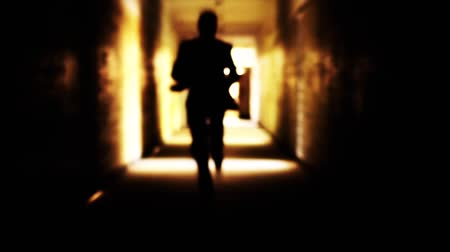 cavalheiro : Man in Suit Running Toward Shining Light Salvation Freedom Concept HD Stock Footage