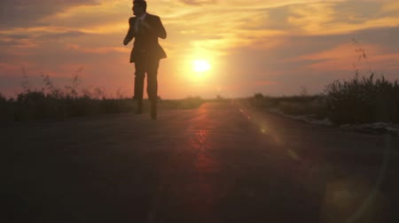 career success : Man in Suit Business Running Road Sunset Path HD
