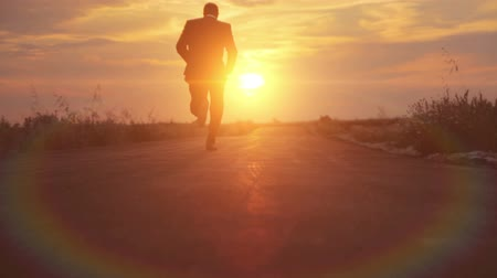 career success : Man Silhouette Business Road to Success Runnning Sunset HD Stock Footage
