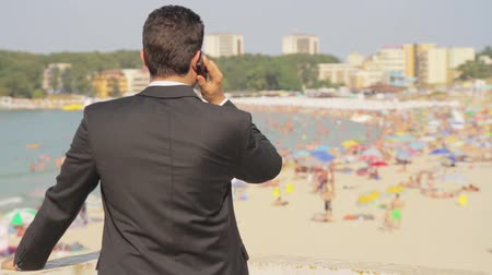 suit and tie : Successful Businessman Cellphone Vacation Beach Concept HD