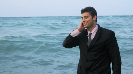 ludzik : Businessman Speaking on the Phone at sea HD