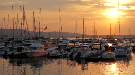 sunset sea : Sunset Marina Yachts Port Vacation Concept HD Stock Footage