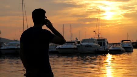 владелец : Man Talking on Cellphone at Yacht  Harbour Vacation HD