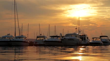 sunset sea : Sunset over Yachts HD Stock Footage