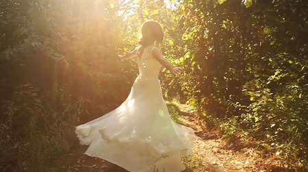ruha : Woman Spinning Dress Slow Motion Nature Sun Forest Happiness Stock mozgókép