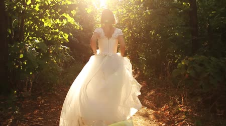 ruha : Bride Running in Forest Slow Motion HD Stock mozgókép