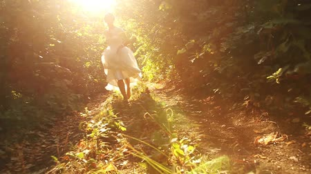 mese : Wedding Bride Running in Forest Slow Motion HD