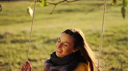 ormanda yaşayan : Happy Young Woman Enjoying Swing in Nature