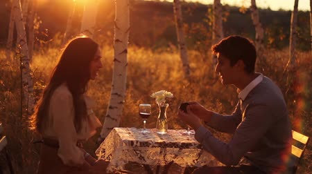 birlik : Young Couple Marriage Proposal at Sunset Romance Concept