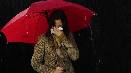 üfleme : Sick Woman Holding Umbrella Blowing Nose Cold Symptoms Stok Video