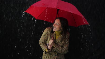 nedves : Young Woman Holding Red Umbrella Laughing in the Rain