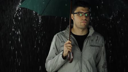 крик : Young Man Umbrella Upset About Rainy Weather Storm Concept Стоковые видеозаписи