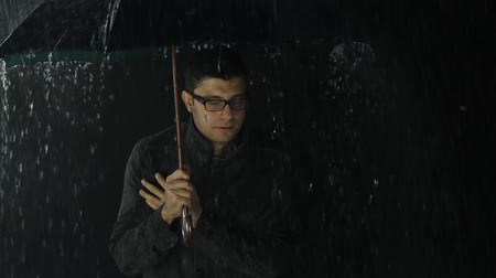 gravata : Young Man Cold Freezing in Rain Bad Weather Storm Concept Stock Footage