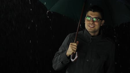 deszcz : Smiling Young Man in the Rain Dancing Happy