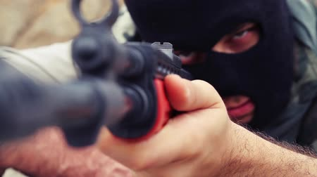 terrorizmus : Terrorism Concept dangerous Masked Man Aiming  to Shoot