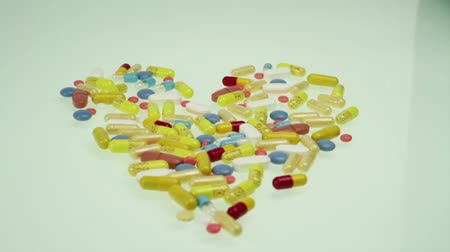 addiction recovery : Heart Shape Colorful Pills Health Medicine Concept