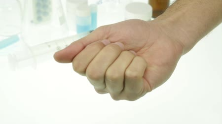 addiction recovery : Man Hand holding medicine pills addiction
