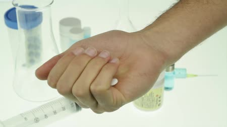addiction recovery : Addiction to medication Hand Holding Tablets