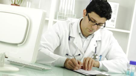 general practitioner : Young Doctor Writing Handing RX Prescription Focus Change