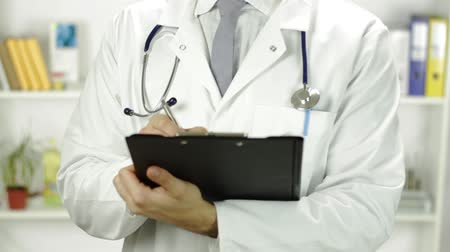 general practitioner : Doctor Torso Writing Rx Prescription Handing Close Up Stock Footage
