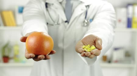 przychodnia : Fruit Versus Pills Choice Doctor Hands