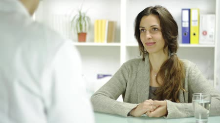 prescribe : Beautiful Young Woman Recieving RX Prescription Doctors Office Stock Footage