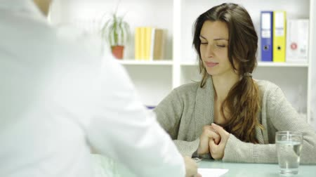 biurko : Smiling Young Woman Taking Prescription from Doctor