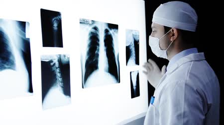 stomatologia : X ray examination wall young doctor looking for illness