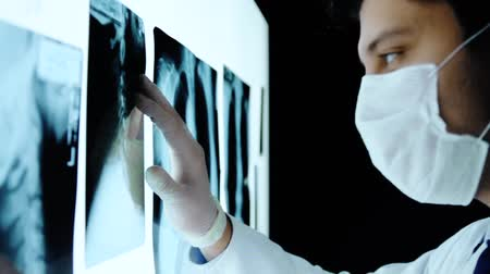 healthy office : Doctor Hands Touching X ray Scans Dark Room