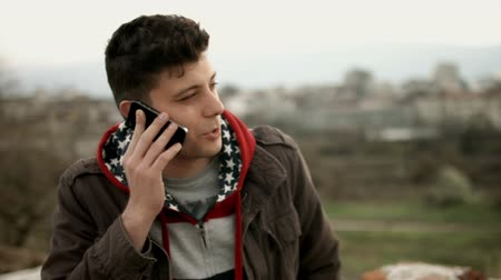 adam : Handsome Young Man Talking on Phone Roof Urban Culture  HD