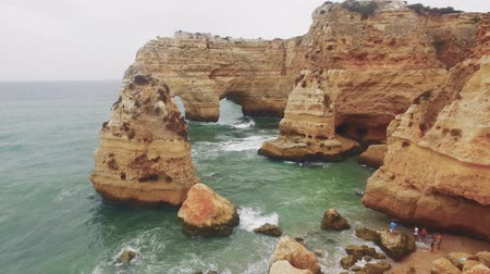 sunset sea : Praia Da Marinha Drone Footage Natural Arch Atlantic Beach Idyllic Cliff Europe Emblematic Famous Geology Nature Portugal Rock Sea Travel Stock Footage