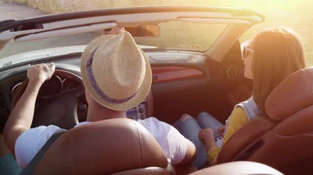 Fun Young Couple In A Convertible Cabriolet Car Driving By The Beach Taking Pictures Summer Vacation Concept