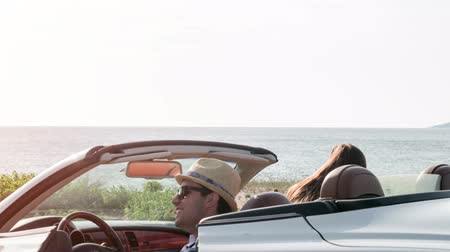 Happy Man And Woman Arrive At Beach In Convertible Car Happy Holiday Vacation Day Off Beautiful Seaside Travel Concept Dostupné videozáznamy