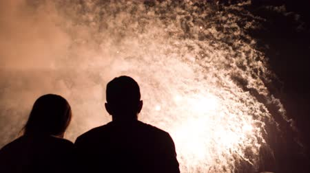 Man And Woman Silhouettes Hugging In Front Of Fireworks Demonstration New Years Eve Celebration Young Love Romantic Relationship Proposal Concept