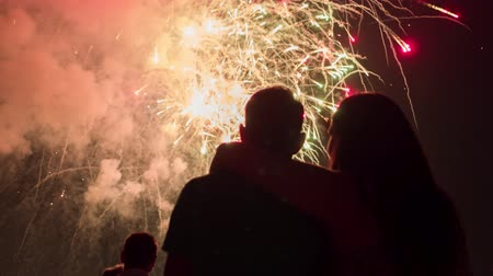 Beautiful Fireworks As Man And Woman Hogging Silhouettes At New Years Eve Romantic Relationship Family Concept