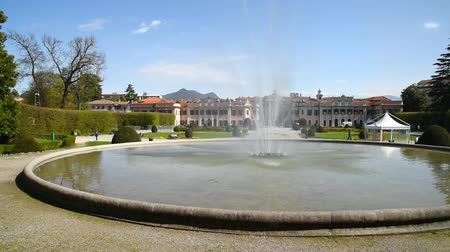 lobi : View of Estense Palace (Palazzo Estense) with a fountain in front, it is one of the most popular place of Varese, Lombardy, Italy. Stok Video