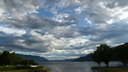 greater : Time lapse of cloudy sky at sunset above Lake Maggiore in Maccagno, Italy Stock Footage