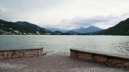 damar : Panoramic view of Lake Lugano - Ceresio with fountain in Lavena Ponte Tresa, province of Varese, Italy