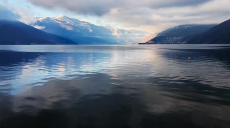 jezero : Time Lapse of Lake Maggiore in cloudy day, Luino, province of Varese, Italy