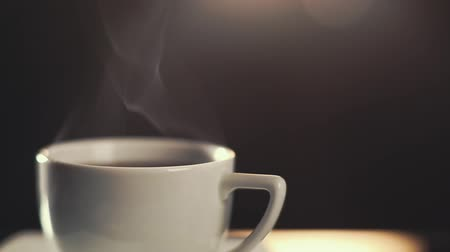 HD video of classic coffee cup with steam rising Стоковые видеозаписи