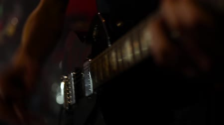 electro : Man playing electro guitar in the club Stock Footage