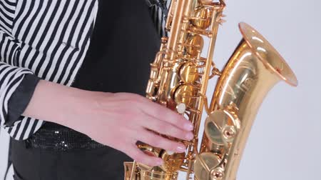jazzman : A man playing the saxophone.