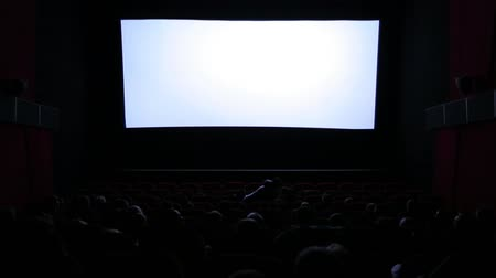 stage theater : White screen and people in the cinema.