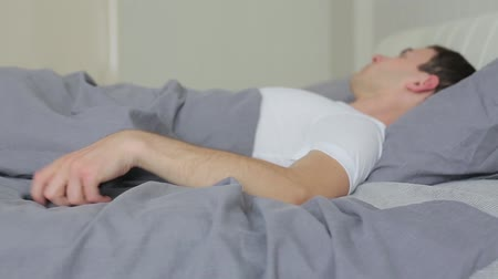 turning off : Man wakes up and turns off the alarm on the phone. Stock Footage