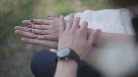 holding : Couple holding hands close up. Stock Footage