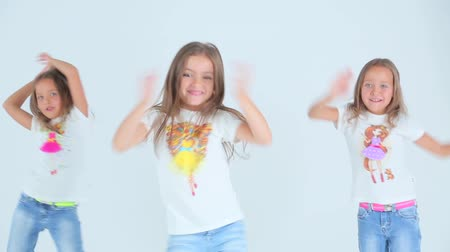 anaokulu : Little girls dancing on a white background. Stok Video